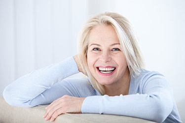 smiling woman with gray hair