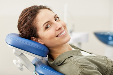 Smiling woman in Capital District's trusted emergency dentist office