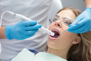 Woman dental exam with intraoral camera