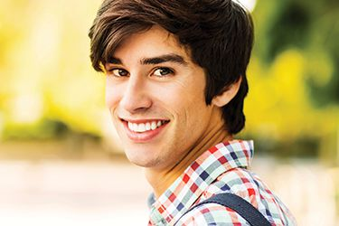 Young man with perfectly straight smile