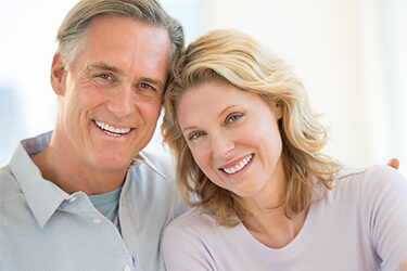 Older smiling couple with healthy teeth and gums