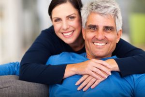 attractive middle-aged couple smiling