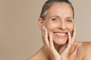 Senior woman happy with her decision to transition from dentures