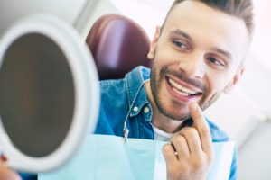 Smiling dental implant candidate in the Capital District