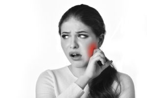 black and white photo of woman in need of jaw pain relief