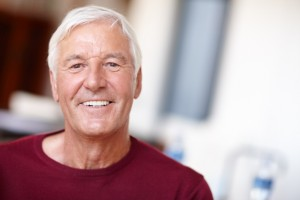 Man with a beautiful smile thanks to his all-on-4 dental implants